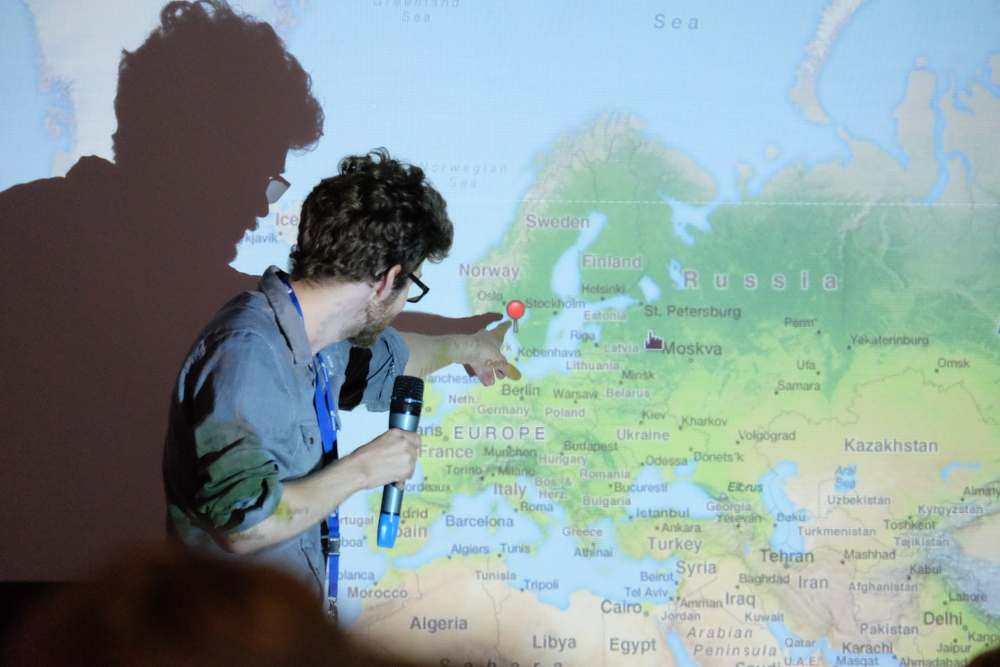 Andreas Nilsson shows the location of GUADEC 2015. (Photo by Garrett LeSage.)