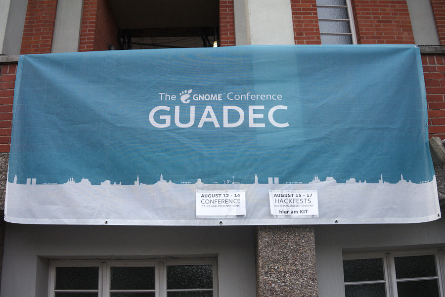 Banner outside of venue. Photo Credit: Oliver Propst CC BY-SA 3.0